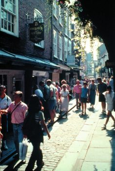 The Shambles, York, North Yorkshire - People strolling down the Shambles towards Pavement © www.visityork.org